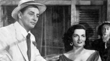 Mitchum & Russell arrive in Macao shortly after she has picked his pocket of all ready cash!